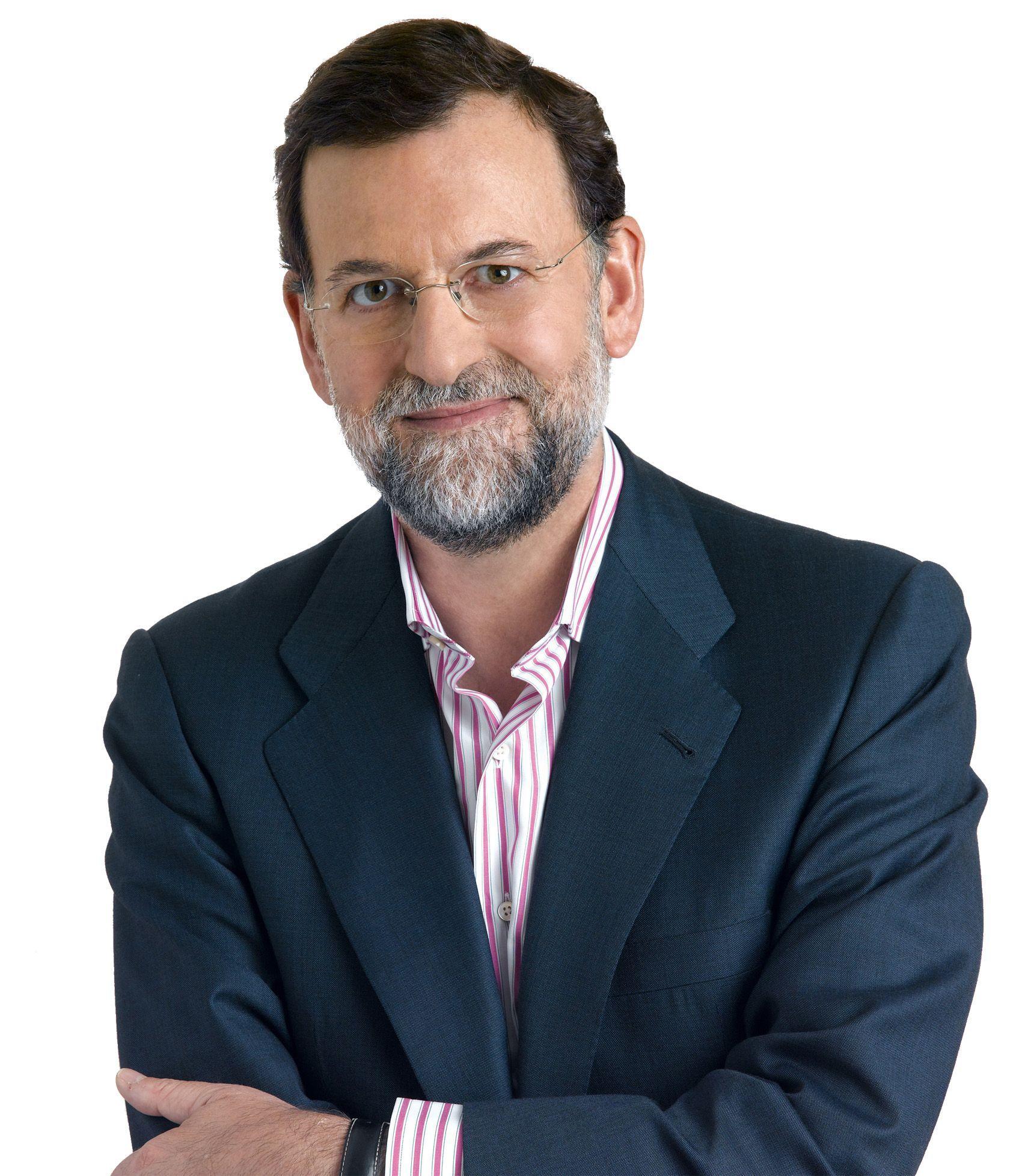 Posado Rajoy sin corbata